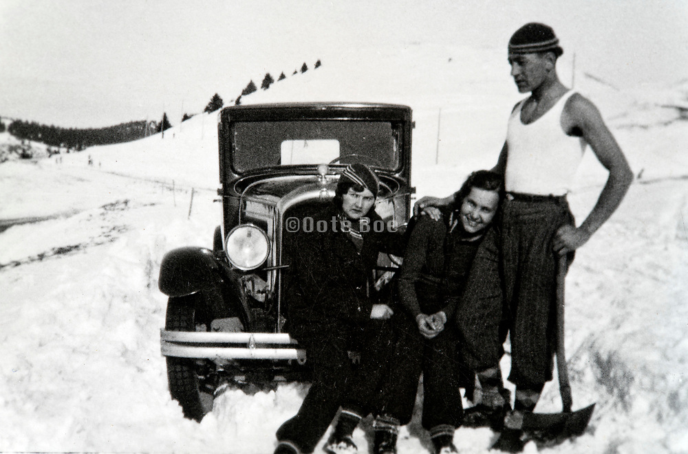 people smiling with car stuck in the snow  France Alps 1933