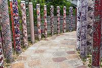 "Arashiyama Station's facelift includes designer Yasumichi Morita creations of kimono fabric patterns arranged on cylindrical columns.  The patterns have been placed inside 600 illuminated poles along pathways of the station, creating a ""kimono forest""."