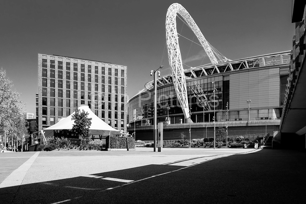 EDITORS NOTE: Image has been converted to black and white. Wembley Stadium, the home of the UKs national soccer team, and the largest stadium in the UK, is deserted due to lockdown as a result of the Coronavirus Pandemic on 16th April 2020 in London, United Kingdom. Coronavirus or Covid-19 is a new respiratory illness that has not previously been seen in humans. Much of Europe has been placed into lockdown, with stringent rules in place as part of a long term strategy, and in particular social distancing, and a stay at home policy.