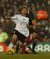 Photo: Javier Garcia/Back Page Images<br />Fulham v Manchester United, FA Barclays Premiership, Craven Cottage 13/12/04<br />Ryan Giggs stops Steed Malbranque in his tracks