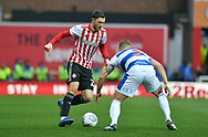 Brentford defender Henrik Dalsgaard (22) and Queens Park Rangers Jake Bidwell*** during the EFL Sky Bet Championship match between Brentford and Queens Park Rangers at Griffin Park, London, England on 2 March 2019.