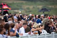 Ffos Las Racecourse, Trimsaran, Wales, UK. Friday 24 August 2018.  A man at Ffos Las Racecourse enjoys the atmosphere of Ladies' Day