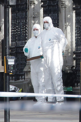 Emergency personnel close to the Palace of Westminster, London, after policeman has been stabbed and his apparent attacker shot by officers in a major security incident at the Houses of Parliament.