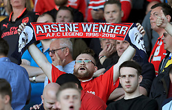 Arsenal fans supporting outgoing manager Arsene Wenger in the stands after the Premier League match at the John Smith's Stadium, Huddersfield.