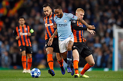 Manchester City's Raheem Sterling (centre) battles for the ball with Shakhtar Donetsk's Viktor Kovalenko (right) and Maycon during the UEFA Champions League match at the Etihad Stadium, Manchester.