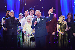 Queen Elizabeth II and the Prince of Wales with Sir Tom Jones (left), Kylie Minogue (right) and other performers on stage at the Royal Albert Hall in London during a star-studded concert to celebrate the Queen's 92nd birthday.