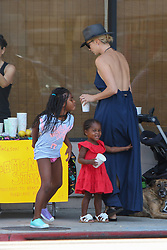 EXCLUSIVE: Charlize Theron was spotted helping her daughters selling lemonade supporting hurricane relief effort, in Melrose Av. West Hollywood, LA. 09 Sep 2017 Pictured: Charlize Theron, Jackson Theron, August Theron. Photo credit: MEGA TheMegaAgency.com +1 888 505 6342
