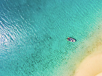 Aerial view of a research boat anchored off of South Island, Lizard Island, Great Barrier Reef, Queensland, Australia