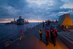SOUTH CHINA SEA (May 6, 2017) Sailors aboard Arleigh Burke-class guided-missile destroyer USS Sterett (DDG 104) prepare to join Arleigh Burke-class guided-missile destroyer USS Dewey (DDG 105) in conducting a replenishment-at-sea with Henry J. Kaiser-class fleet replenishment oiler USNS John Ericsson (T-AO 194). Sterett and Dewey comprise the Sterett-Dewey Surface Action Group and is the third deploying group operating under the command and control construct called 3rd Fleet Forward. U.S. 3rd Fleet operating forward offers additional options to the Pacific Fleet commander by leveraging the capabilities of 3rd and 7th Fleets. (U.S. Navy photo by Mass Communication Specialist 1st Class Byron C. Linder/Released)170506-N-ZW825-499 <br /> Join the conversation:<br /> http://www.navy.mil/viewGallery.asp<br /> http://www.facebook.com/USNavy<br /> http://www.twitter.com/USNavy<br /> http://navylive.dodlive.mil<br /> http://pinterest.com<br /> https://plus.google.com