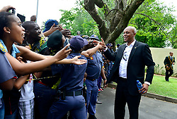 256<br /> Soccer legend Doctor Khumalo greets fans outside the late President Nelson Mandela's home in Houghton where he and other legends paid their respects to the Mandela family.<br /> 071213. Picture: Bongiwe Mchunu