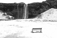 Lonely Observation Bench in the Snow at Seljalandsfoss, a Waterfall in Southern Iceland. Image taken with a Leica X2 camera (ISO 100, 24 mm, f/5.6, 1/125 sec).