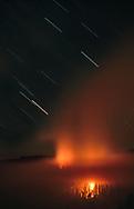Prescribed fire, mixed-conifer forest, night, star trails. Yosemite National Park, CA, © David A. Ponton