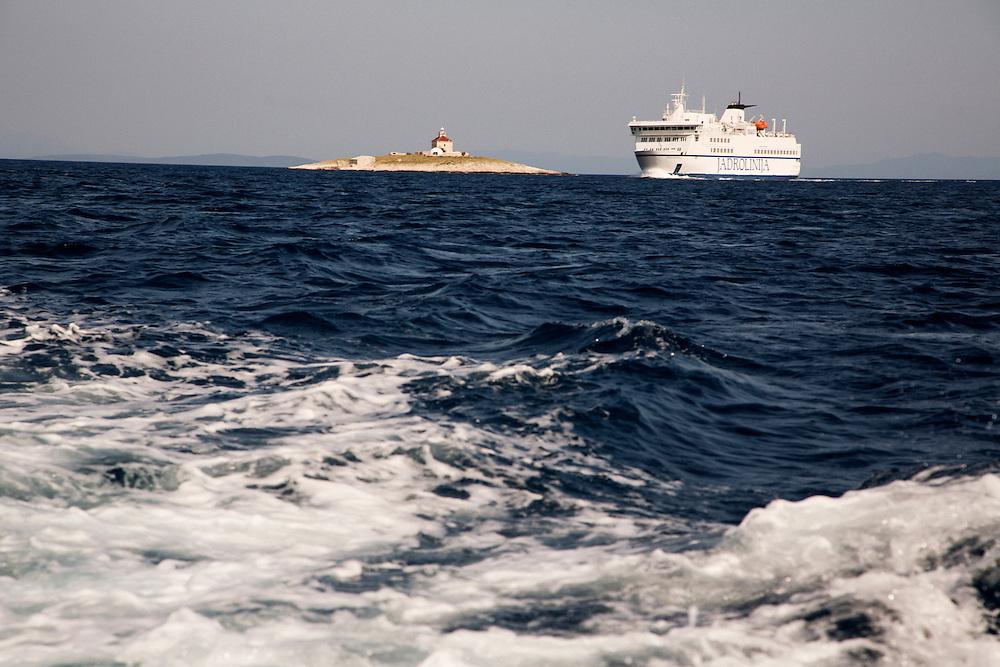 Travel in Croatia<br /> <br /> A ferry heading to Split passes by the lighthouse near Hvar town on Hvar Island.<br /> <br /> June 2013<br /> Matt Lutton