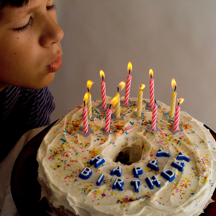 light energy, heat energy, boy blowing out candles on birthday cake
