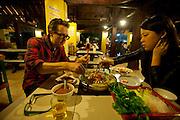 Jack Menzel and Juliet eating at a local restaurant in Ban Saylom, Luang Prabang, Laos.