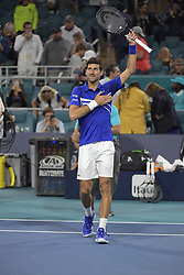 March 22, 2019 - Miami Gardens, Florida, United States Of America - MIAMI GARDENS, FLORIDA - MARCH 22: Novak Djokovic of Serbia defeats Bernard Tomic of Australia during the Miami Open day 5 Presented by Itau at Hard Rock Stadium March 22, 2019 in Miami Gardens, Florida..People: Novak Djokovic. (Credit Image: © SMG via ZUMA Wire)