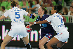 Mendy Claudine of France and Jericek Nina of Slovenia during handball match between National teams of Slovenia and France of 2011 Women's World Championship Play-off, on June 12, 2011 in Arena Stozice, Ljubljana, Slovenia. (Photo By Urban Urbanc / Sportida.com)