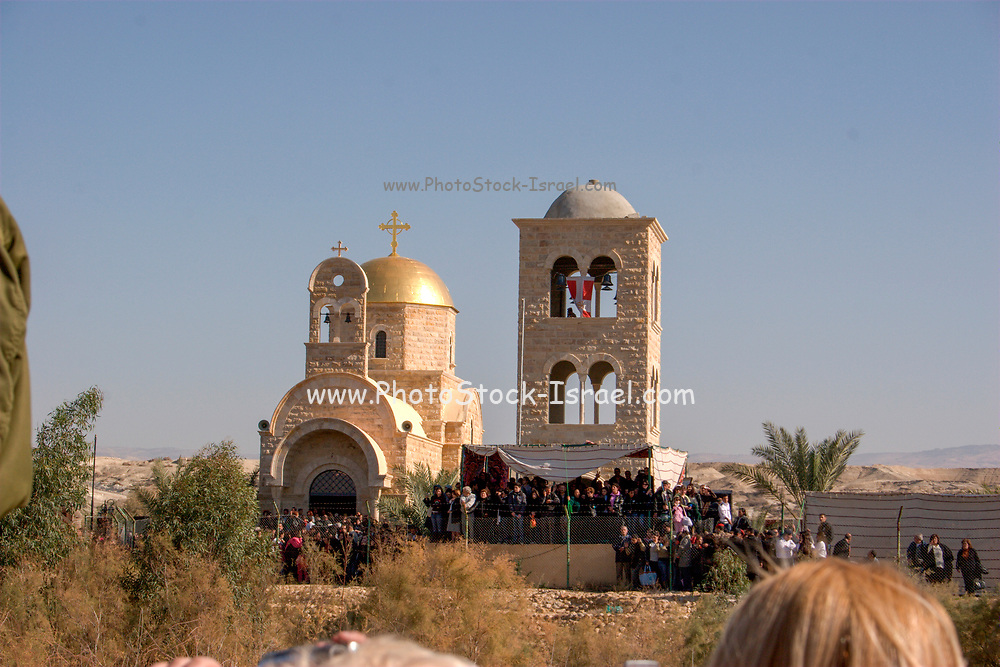 """Israel, Jordan River, Near Jericho, Qasr al Yahud. The Greek Orthodox Church on the Jordanian side of the river January 18th 2008. Epiphany, the day of Jesus' baptism, when """"the heavens opened, and he saw the spirit of God descending like a dove and lighting on him."""" Celebrated in January by the Greek Orthodox Church. The holy day transforms the area as thousands of pilgrims flock to what is one of the most sacred and least visited places in Israel."""