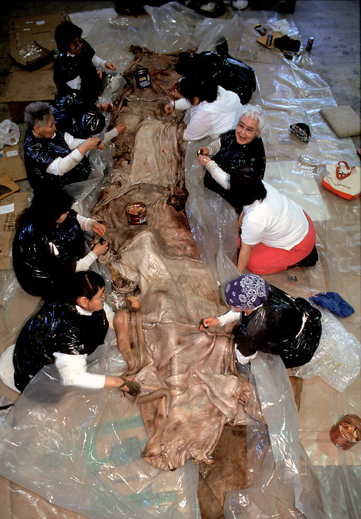 Barrow, Alaska, Native women working together to sew seal skins for a traditional umiak, the canoe used to hunt for whales, seals and walruss