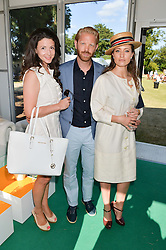 Left to right, SHIRLEY LEIGH WOOD-OAKES, ALISTAIR GUY and THYRA OCTOBER at the Summer Solstice Party during the Boodles Tennis event hosted by Beulah London and Taylor Morris at Stoke Park, Park Road, Stoke Poges, Buckinghamshire on 21st June 2014.