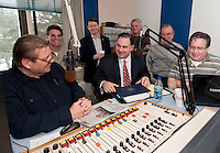 """WEZS talk radio host Niel Young welcomes Congressman Frank Guinta to the  """"The Advocates"""" Saturday morning. Looking on are former Franklin Mayor Tony Giunta, Franklin Mayor Ken Merrifield, City Councilor Robert Hamel, NH State Rep. Harry Accornaro and Rep. Paul Hopgarten.  (not pictured Laconia city chair Tom Brown Jr.)   Young was presented with a proclamation from Congressman Guinta celebrating his 15 years of radio broadcasting.   (Karen Bobotas/for the Laconia Daily Sun)"""