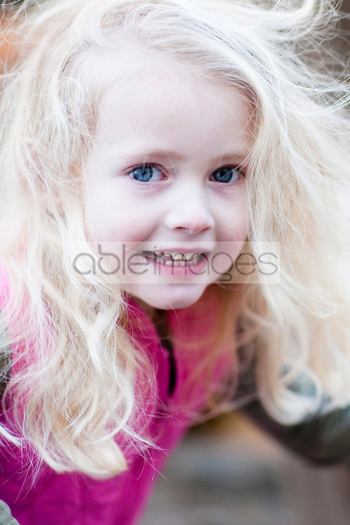 Close up of a blonde girl with wind in her hair