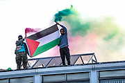 Birmingham, United Kingdom, June 14, 2021: Arconic admin offices appear to be occupied by Palestine Action activists who stormed the site on red paint on Monday, June 14, 2021. Activists who climbed the roof and occupied the building are holding flare and Palestinian flag on the rooftop of the main entry gate of the factory. Arconic is an American industrial company specializing in lightweight metals engineering and manufacturing known as Arconic in Bermingham on Monday, June 14, 2021.  (Photo by Vudi Xhymshiti)