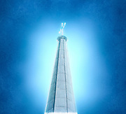 Digitally manipulated image of a spire of church with a crucifix