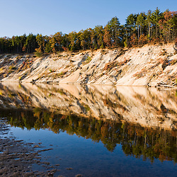 Sandy bluffs carved by the Merrimack River in Canterbury, New Hampshire.