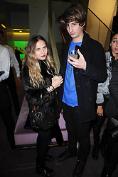 OSCAR BURNETT and ESME HODSOLL at a party hosted by Prada to celebrate launch of a book documenting the company's diverse projects in fashion, architecture, film and art held at their store 16/18 Old Bond Street, London on 19th November 2009.