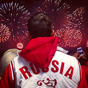 A spectator watches the fireworks that ended closing ceremonies from Fisht Stadium on Sunday, Feb. 23, 2014. Sochigrams during the Winter Olympics in Sochi, Russia with an iPhone and Instagram. (Brian Cassella/Chicago Tribune) B583527420Z.1 <br /> ....OUTSIDE TRIBUNE CO.- NO MAGS,  NO SALES, NO INTERNET, NO TV, CHICAGO OUT, NO DIGITAL MANIPULATION...