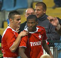 Fotball<br /> Foto: Wrofoto/Digitalsport<br /> NORWAY ONLY<br /> <br /> UEFA Champions League third qualifying round soccer match in Krakow, Poland, on Tuesday, Aug. 9, 2005<br /> WISLA KRAKOW v PANATHINAIKOS ATHENS<br /> KRAKOW 09/08/2005<br /> <br /> AWEL BROZEK & KALU UCHE CELEBRATE SECOND GOAL FOR WISLA