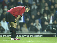 Photo: Aidan Ellis.<br /> Blackburn v Manchester United. Barclays Premiership. 01/02/2006.<br /> United's Rio Ferdinand can believe he has been sent off for the challenge on Blackburn's Robbie Savage