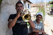 Spontaneous music session by a family and their neighbours on the streets of the Roma part in the city of Crnik, Macedonia.