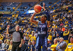 Dec 1, 2019; Morgantown, WV, USA; Rhode Island Rams guard Fatts Russell (1) shoots a three pointer during the first half against the West Virginia Mountaineers at WVU Coliseum. Mandatory Credit: Ben Queen-USA TODAY Sports