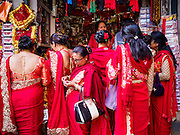 05 MARCH 2017 - KATHMANDU, NEPAL: Newar Buddhist women socialize after a service at Seto Machindranath Temple, a 12th century Buddhist temple in Kathmandu. The Newar people are the dominant ethnic group in the Kathmandu valley. Newar Buddhists combine elements of Buddhism and Hinduism in their faith.     PHOTO BY JACK KURTZ