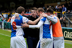 Bristol Rovers' David Clarkson celebrates with his team mates after scoring the winning goal with a pitch invader - Photo mandatory by-line: Dougie Allward/JMP - Mobile: 07966 386802 26/04/2014 - SPORT - FOOTBALL - High Wycombe - Adams Park - Wycombe Wanderers v Bristol Rovers - Sky Bet League Two