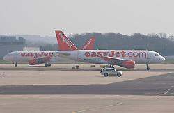 © licensed to London News Pictures. London, UK 23/03/2012. EasyJet airplanes preparing for take off at Gatwick Airport. Photo credit: Tolga Akmen/LNP