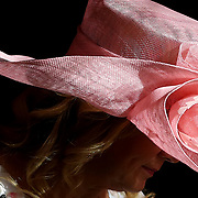 Sherri Stansbury walks through a ray of light while sporting a colorful hat during the Sylvania Country Club's annual Kentucky Derby party in Sylvania, Ohio, on Saturday, May 4, 2019. THE BLADE/KURT STEISS