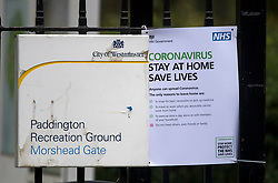 © Licensed to London News Pictures. 28/03/2020. London, UK. An NHS sign asking people to stay at home, at Paddington Recreation Ground in London, during a lockdown over the spread of COVID-19. Prime Minister Boris Johnson has announced that people should only leave their homes for essential work, groceries, medical necessity and exercise. Photo credit: Ben Cawthra/LNP