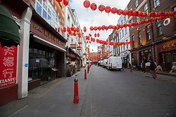 © Licensed to London News Pictures. 16/03/2020. London, UK. Gerrard Street in Chinatown appears quiet this afternoon . New cases of the COVID-19 strain of Coronavirus are being reported daily as the government outlines it's plans for controlling the outbreak. Photo credit: George Cracknell Wright/LNP