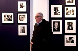 © Licensed to London News Pictures 08/04/2013.Photographer Mark Gerson, 91, poses infront of some of his photos on display at Bonhams Auction House in London. .A selection of his prints will be sold as part of the 'Roy Davids Collection Part III: Poetry: Poetical Manuscripts and Portraits of Poets', on 10th April and 8th May, at Bonhams, London. .London, UK.Photo credit: Anna Branthwaite