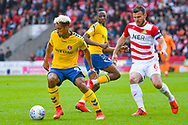 Lyle Taylor of Charlton Athletic (9) and Andrew Butler of Doncaster Rovers (6) in action during the EFL Sky Bet League 1 play off first leg match between Doncaster Rovers and Charlton Athletic at the Keepmoat Stadium, Doncaster, England on 12 May 2019.