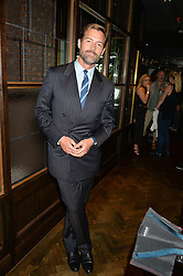 PATRICK GRANT at a party to celebrate the launch of Sackville's Bar & Grill, 8a Sackville Street, London on 15th July 2015.