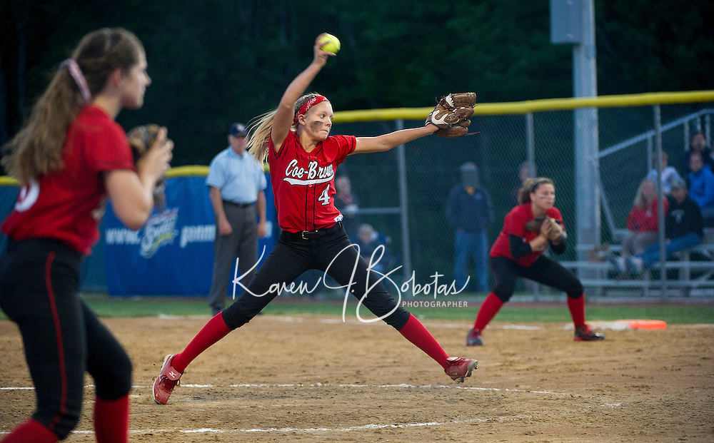 Coe Brown's Kianna Daudelin throws in a pitch during NHIAA Division II Softball Semi Final at SNHU Tuesday evening.  (Karen Bobotas/for the Concord Monitor)