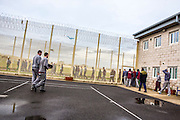 Prisoners leaving to go to work. Beaufort House, a skill development unit for enhanced prisoners. Part of HMP/YOI Portland, a resettlement prison with a capacity for 530 prisoners.© Prisonimage.org Any image use must be agreed first. All images must be credited.