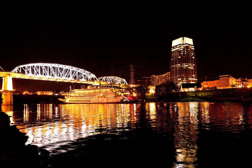 Nashville Riverfront and riverboat reflection at night
