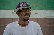 A man poses for a portrait in Amor de Deus Recovery Center, Del Castilho, Rio de Janeiro.