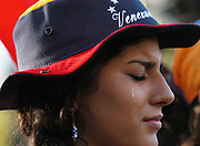 An opposition protester weeps during a peace rally held in downtown Caracas, Venezuela, Sunday, March 14, 2004.  The opposition, which is working to oust President Hugo Chavez, received a major blow last week when the government's National Electoral Council (CNE) said the opposition fell short on signatures for a petition to vote on an end to the Chavez persidency.  The constitution requires 2.4 million signatures for a recall vote.  While the opposition claims it collected 3.4 million votes, the CNE has validated only 1.8 million, sparking massive protests, and clashes between the opposition and Venezuelas National Guard.  Photographer: Emile Wamsteker