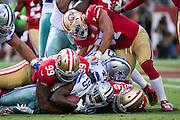 The San Francisco 49ers dog-pile Dallas Cowboys running back Lance Dunbar (25) at Levis Stadium in Santa Clara, Calif., on October 2, 2016. (Stan Olszewski/Special to S.F. Examiner)